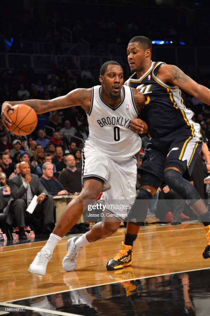 <a gi-track='captionPersonalityLinkClicked' href=/galleries/search?phrase=Andray+Blatche&family=editorial&specificpeople=4282797 ng-click='$event.stopPropagation()'>Andray Blatche</a> #0 of the Brooklyn Nets drives against <a gi-track='captionPersonalityLinkClicked' href=/galleries/search?phrase=Derrick+Favors&family=editorial&specificpeople=5792014 ng-click='$event.stopPropagation()'>Derrick Favors</a> #15 of the Utah Jazz during the game at the Barclays Center on December 18, 2012 in Brooklyn, New York.