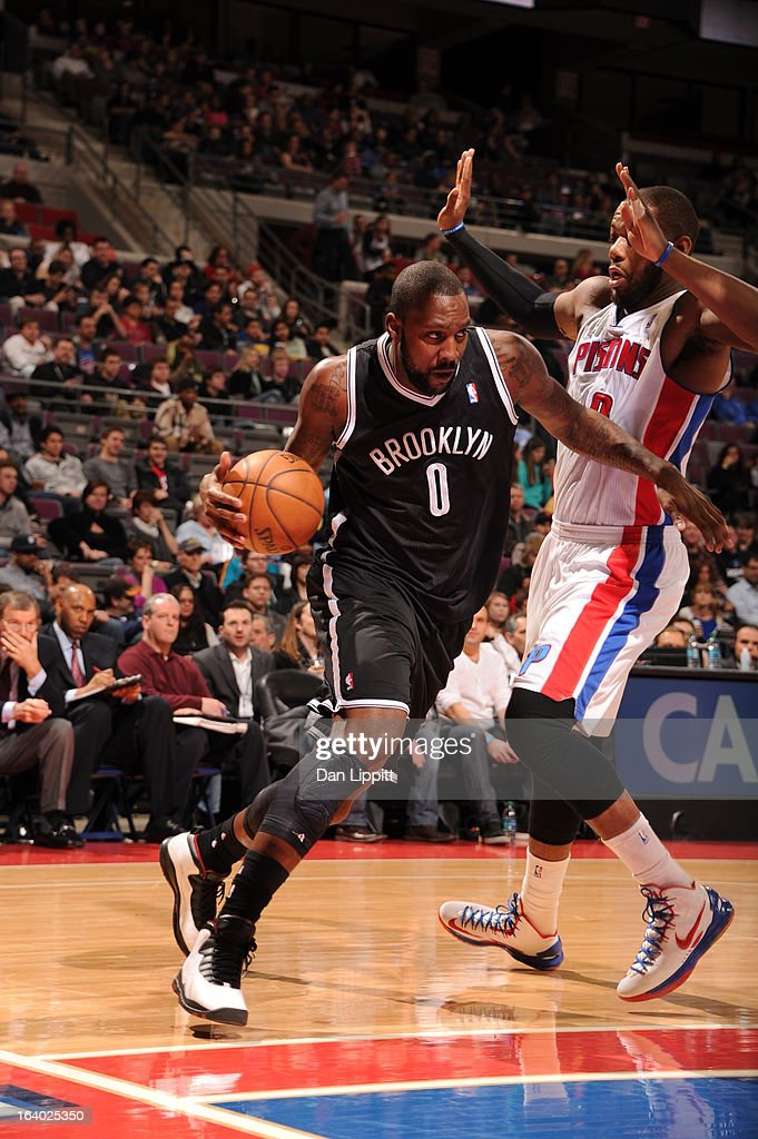 <a gi-track='captionPersonalityLinkClicked' href=/galleries/search?phrase=Andray+Blatche&family=editorial&specificpeople=4282797 ng-click='$event.stopPropagation()'>Andray Blatche</a> #0 of the Brooklyn Nets drives against <a gi-track='captionPersonalityLinkClicked' href=/galleries/search?phrase=Greg+Monroe&family=editorial&specificpeople=5042440 ng-click='$event.stopPropagation()'>Greg Monroe</a> #10 of the Detroit Pistons on March 18, 2013 at The Palace of Auburn Hills in Auburn Hills, Michigan.