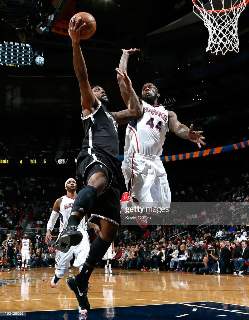 Andray Blatche #0 of the Brooklyn Nets drives against Ivan Johnson #44 of the Atlanta Hawks at Philips Arena on March 9, 2013 in Atlanta, Georgia.