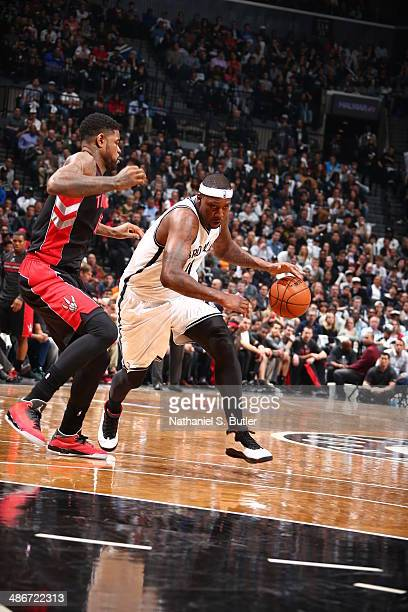 Andray Blatche of the Brooklyn Nets drives against the Toronto Raptors against the Toronto Raptors in Game Three of the Eastern Conference...