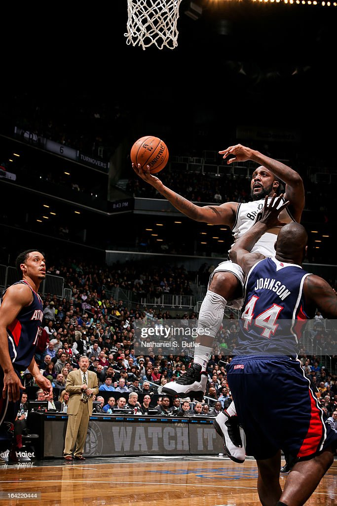 Andray Blatche #0 of the Brooklyn Nets drives to the basket against Ivan Johnson #44 of the Atlanta Hawks on March 17, 2013 at the Barclays Center in the Brooklyn borough of New York City.