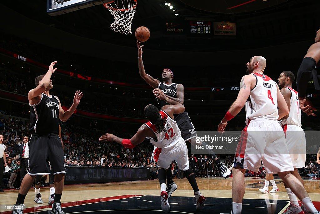 <a gi-track='captionPersonalityLinkClicked' href=/galleries/search?phrase=Andray+Blatche&family=editorial&specificpeople=4282797 ng-click='$event.stopPropagation()'>Andray Blatche</a> #0 of the Brooklyn Nets drives to the basket against <a gi-track='captionPersonalityLinkClicked' href=/galleries/search?phrase=Nene+Hilario+-+Basketball+Player&family=editorial&specificpeople=4250456 ng-click='$event.stopPropagation()'>Nene Hilario</a> #42 of the Washington Wizards at the Verizon Center on November 8, 2013 in Washington, DC.