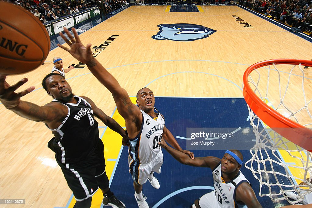 Andray Blatche #0 of the Brooklyn Nets drives to the basket against Darrell Arthur #00 of the Memphis Grizzlies on January 25, 2013 at FedExForum in Memphis, Tennessee.