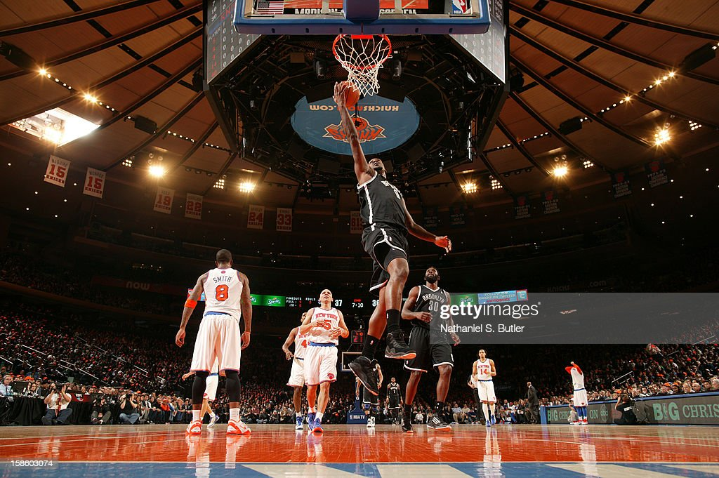 Andray Blatche #0 of the Brooklyn Nets drives to the basket against the New York Knicks on December 19, 2012 at Madison Square Garden in New York City.
