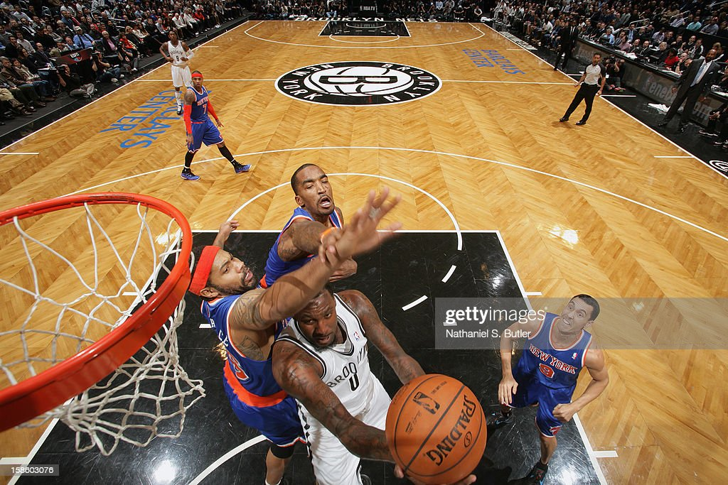 Andray Blatche #0 of the Brooklyn Nets drives to the basket against the New York Knicks on December 11, 2012 at the Barclays Center in the Brooklyn borough of New York City.