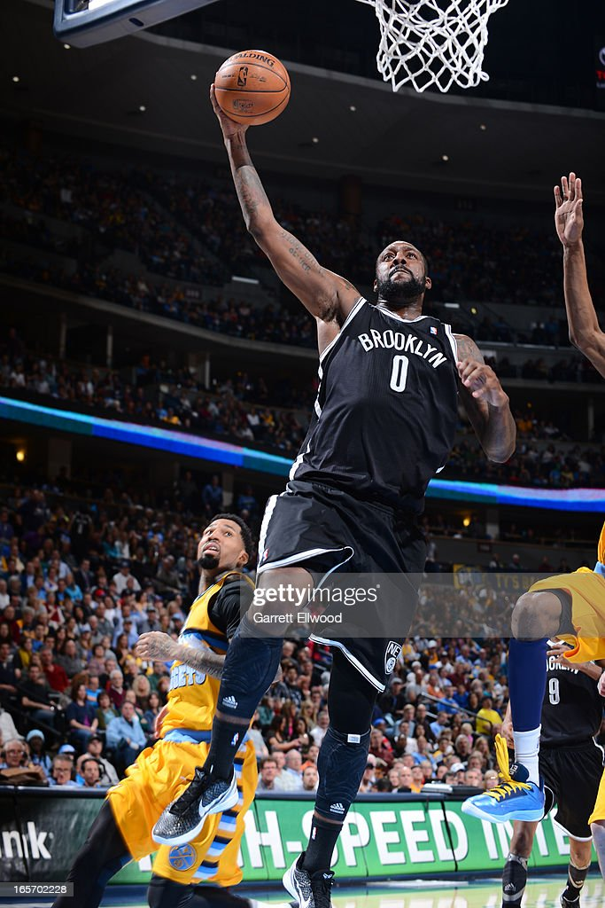 <a gi-track='captionPersonalityLinkClicked' href=/galleries/search?phrase=Andray+Blatche&family=editorial&specificpeople=4282797 ng-click='$event.stopPropagation()'>Andray Blatche</a> #0 of the Brooklyn Nets drives to the basket against the Denver Nuggets on March 29, 2013 at the Pepsi Center in Denver, Colorado.
