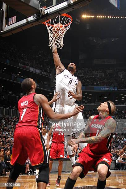 Andray Blatche of the Brooklyn Nets dunks against Chris Bosh of the Miami Heat on January 30 2013 at the Barclays Center in the Brooklyn borough of...