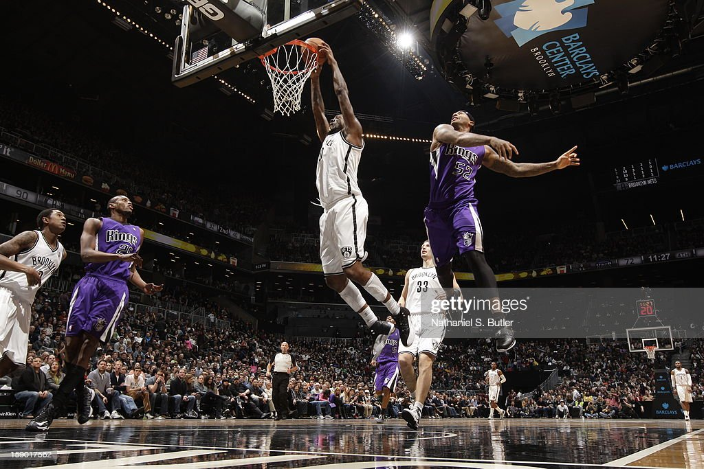 Andray Blatche #0 of the Brooklyn Nets dunks against James Johnson #52 of the Sacramento Kings on January 5, 2013 at the Barclays Center in the Brooklyn borough of New York City.