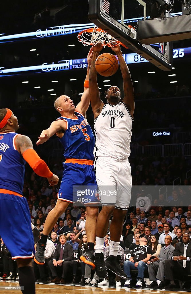 Andray Blatche #0 of the Brooklyn Nets dunks against Jason Kidd #5 of the New York Knicks during their game at the Barclays Center on December 11, 2012 in the Brooklyn borough of New York City.