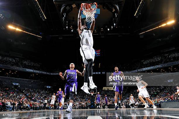Andray Blatche of the Brooklyn Nets dunks against the Sacramento Kings on March 9 2014 at the Barclays Center in Brooklyn New York NOTE TO USER User...