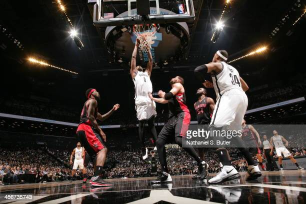 Andray Blatche of the Brooklyn Nets dunks against the Toronto Raptors in Game Three of the Eastern Conference Quarterfinals during the NBA Playoffs...