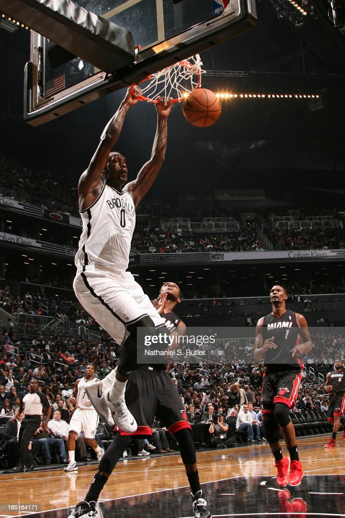Andray Blatche #0 of the Brooklyn Nets dunks during a preseason game against the Miami Heat at the Barclays Center on October 17, 2013 in the Brooklyn borough of New York City.