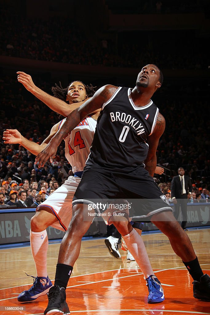 Andray Blatche #0 of the Brooklyn Nets fights for position against Chris Copeland #14 of the New York Knicks on December 19, 2012 at Madison Square Garden in New York City.