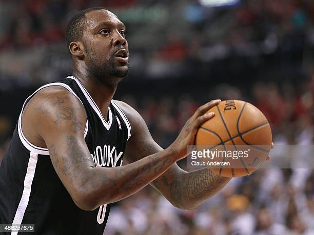 Andray Blatche of the Brooklyn Nets gets set to take a free throw against the Toronto Raptors in Game Seven of the NBA Eastern Conference...