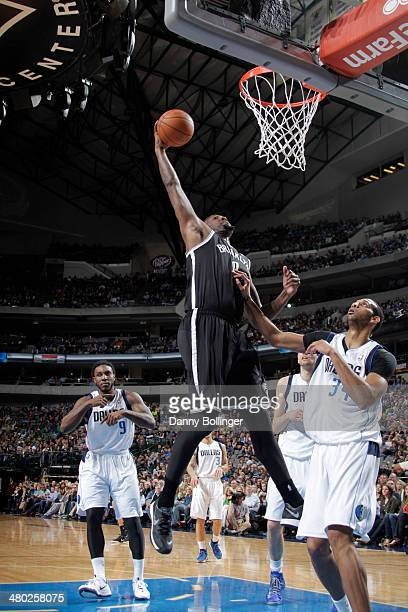 Andray Blatche of the Brooklyn Nets goes in for the dunk against the Dallas Mavericks on March 23 2014 at the American Airlines Center in Dallas...