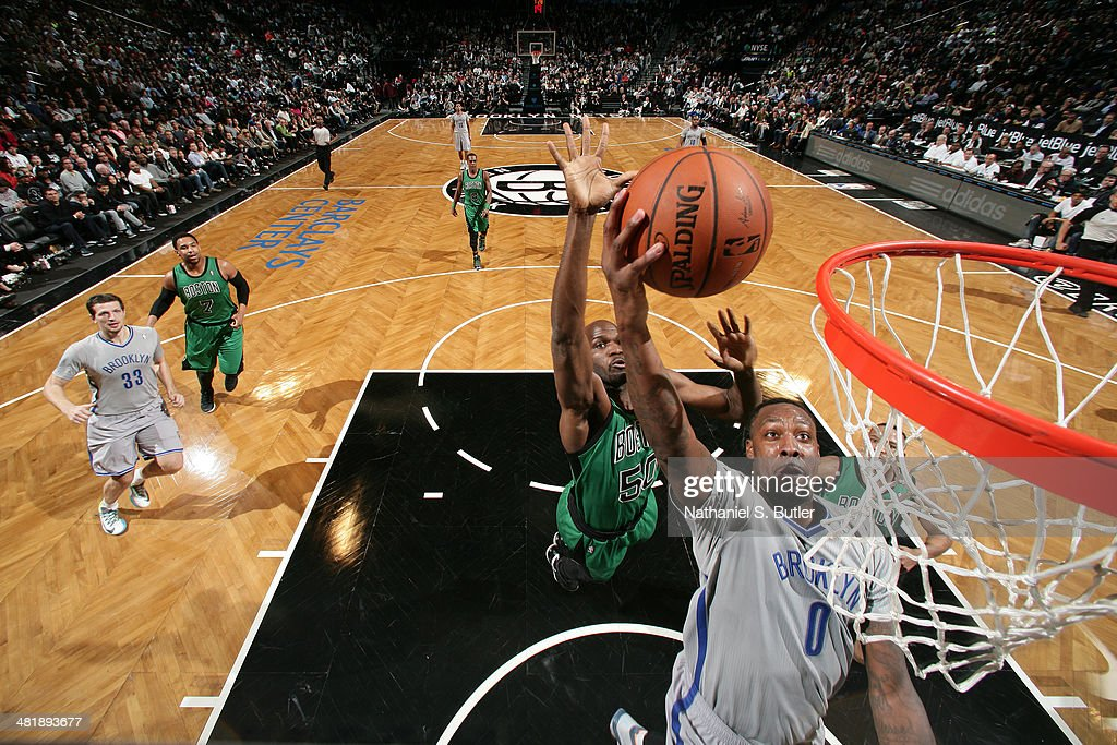 <a gi-track='captionPersonalityLinkClicked' href=/galleries/search?phrase=Andray+Blatche&family=editorial&specificpeople=4282797 ng-click='$event.stopPropagation()'>Andray Blatche</a> #0 of the Brooklyn Nets goes up for a dunk against the Boston Celtics at the Barclays Center on March 21, 2014 in the Brooklyn borough of New York City.