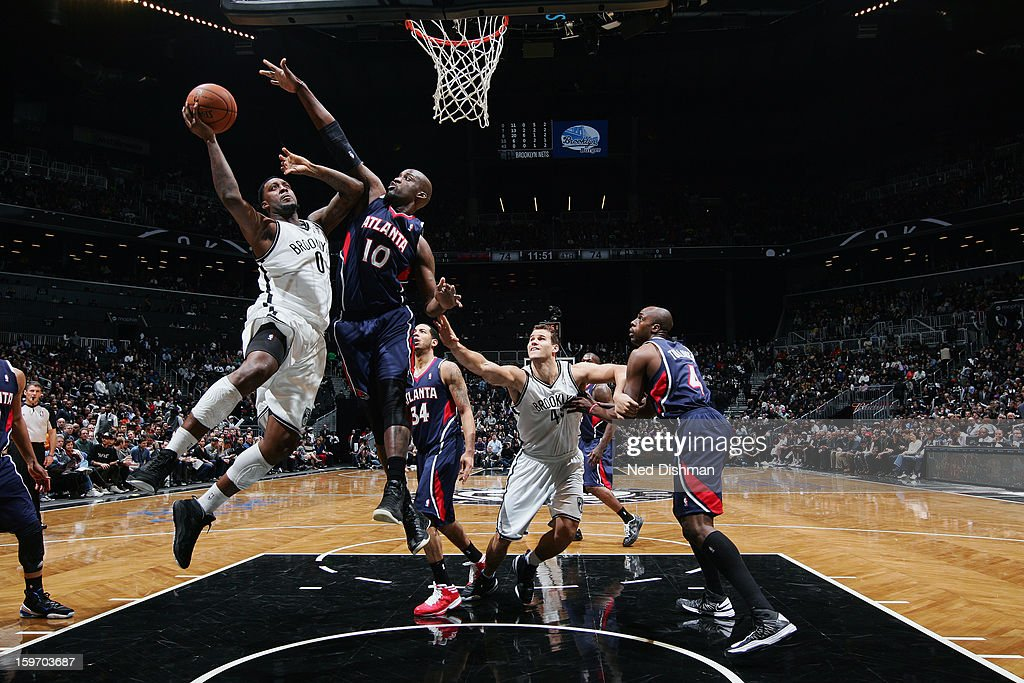 Andray Blatche #0 of the Brooklyn Nets goes up for the layup in traffic against the Atlanta Hawks at the Barclays Center on January 18, 2013 in the Brooklyn borough of New York City in New York City.