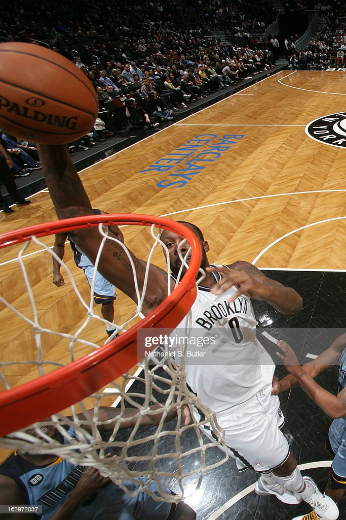 Andray Blatche #0 of the Brooklyn Nets goes up for the slamdunk against the Memphis Grizzlies on February 24, 2013 at the Barclays Center in the Brooklyn borough of New York City.