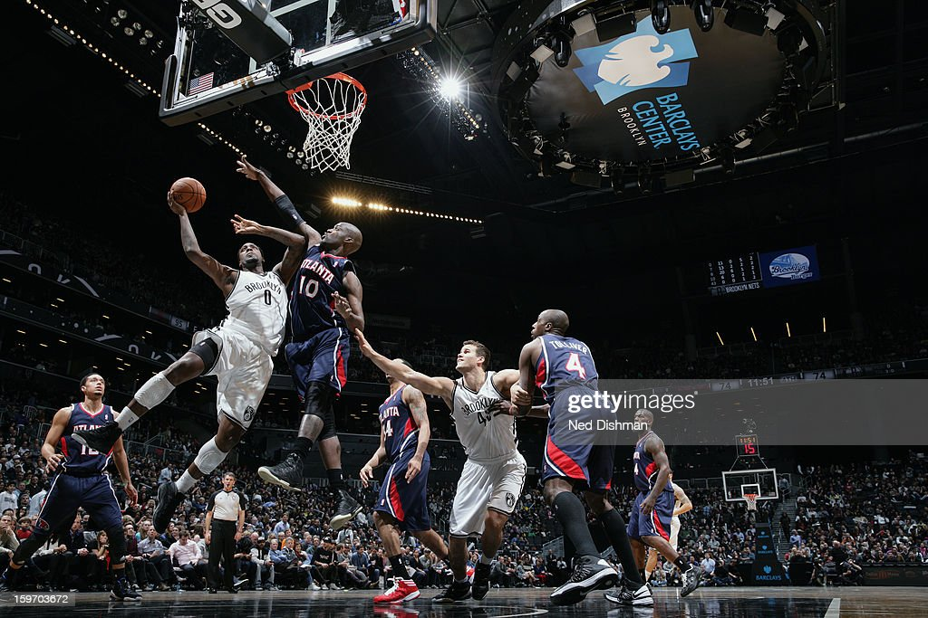 <a gi-track='captionPersonalityLinkClicked' href=/galleries/search?phrase=Andray+Blatche&family=editorial&specificpeople=4282797 ng-click='$event.stopPropagation()'>Andray Blatche</a> #0 of the Brooklyn Nets goes up in traffic against the Atlanta Hawks at the Barclays Center on January 18, 2013 in the Brooklyn borough of New York City in New York City.