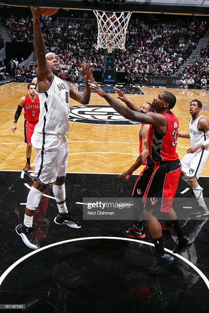 <a gi-track='captionPersonalityLinkClicked' href=/galleries/search?phrase=Andray+Blatche&family=editorial&specificpeople=4282797 ng-click='$event.stopPropagation()'>Andray Blatche</a> #0 of the Brooklyn Nets goes up strong to the hoop against the Toronto Raptors at the Barclays Center on January 15, 2013 in the Brooklyn borough of New York City in New York City.
