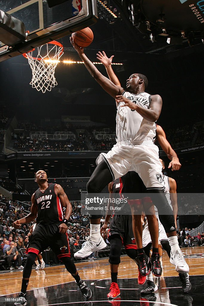 Andray Blatche #0 of the Brooklyn Nets goes up to shoot during a preseason game against the Miami Heat at the Barclays Center on October 17, 2013 in the Brooklyn borough of New York City.