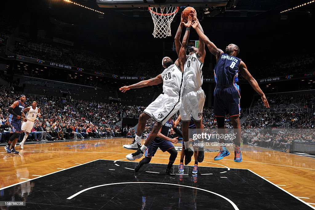 Andray Blatche #0 of the Brooklyn Nets grabs a rebound against the Charlotte Bobcats at the Barclays Center on December 28, 2012 in Brooklyn, New York.