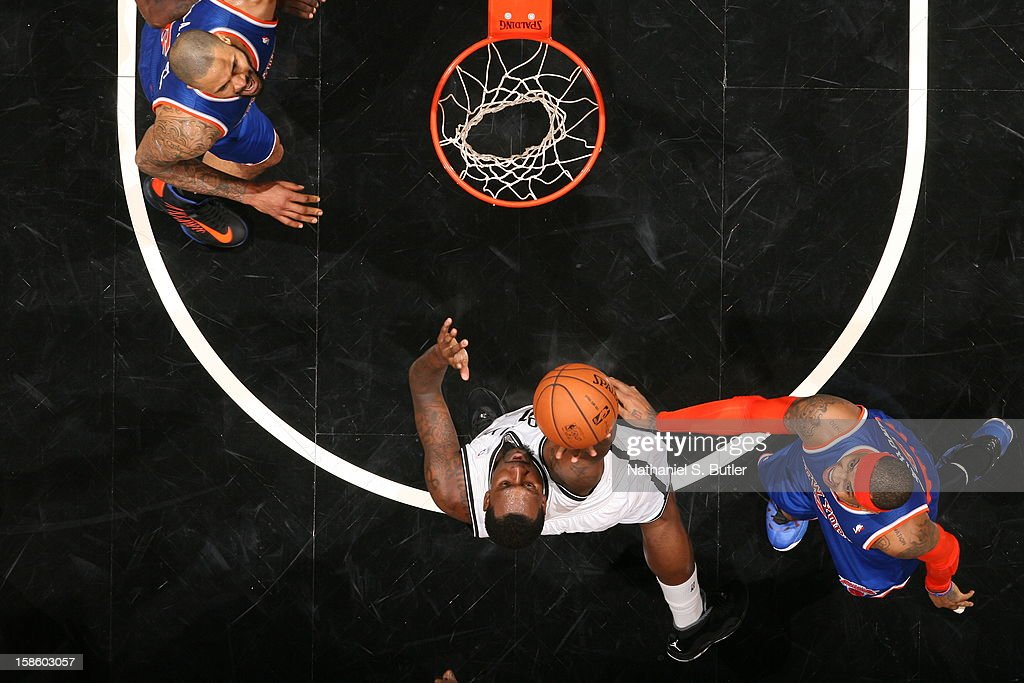 <a gi-track='captionPersonalityLinkClicked' href=/galleries/search?phrase=Andray+Blatche&family=editorial&specificpeople=4282797 ng-click='$event.stopPropagation()'>Andray Blatche</a> #0 of the Brooklyn Nets grabs a rebound against the New York Knicks on December 11, 2012 at the Barclays Center in the Brooklyn borough of New York City.