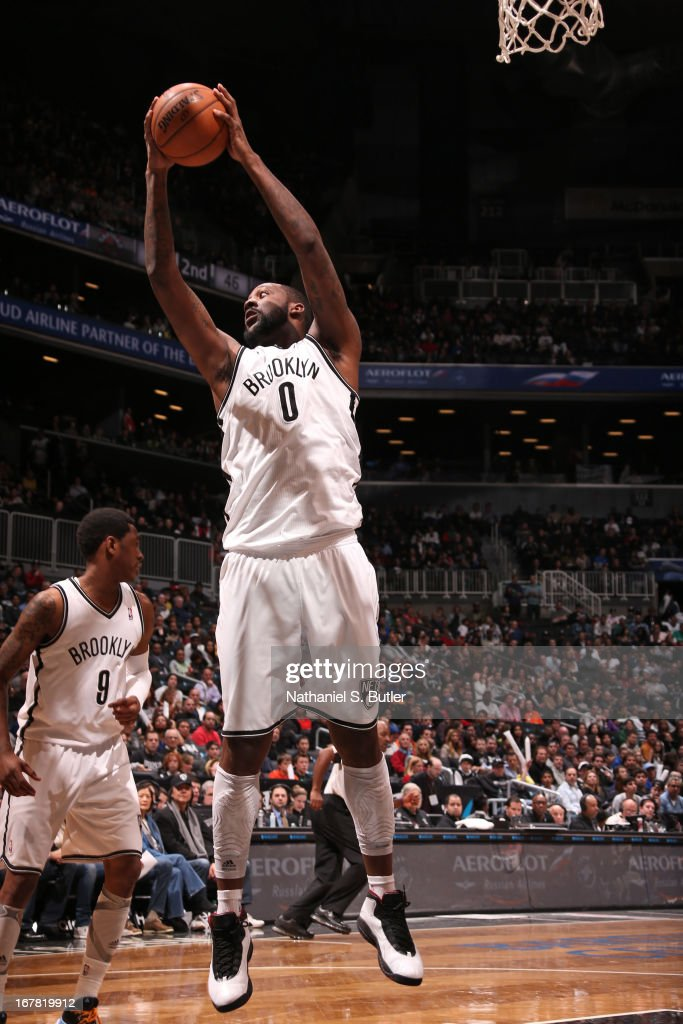 Andray Blatche #0 of the Brooklyn Nets grabs a rebound against the Charlotte Bobcats on April 6, 2013 at the Barclays Center in the Brooklyn borough of New York City.