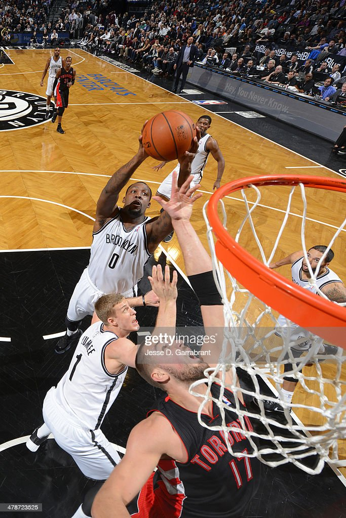 <a gi-track='captionPersonalityLinkClicked' href=/galleries/search?phrase=Andray+Blatche&family=editorial&specificpeople=4282797 ng-click='$event.stopPropagation()'>Andray Blatche</a> #0 of the Brooklyn Nets grabs a rebound against the Toronto Raptors on March 10, 2014 at the Barclays Center in Brooklyn, New York.