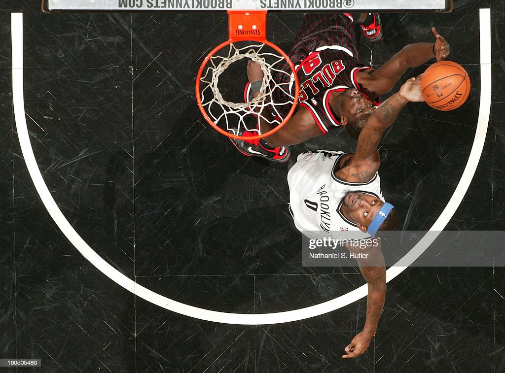 Andray Blatche #0 of the Brooklyn Nets grabs a rebound over Luol Deng #9 of the Chicago Bulls on February 1, 2013 at the Barclays Center in the Brooklyn borough of New York City.