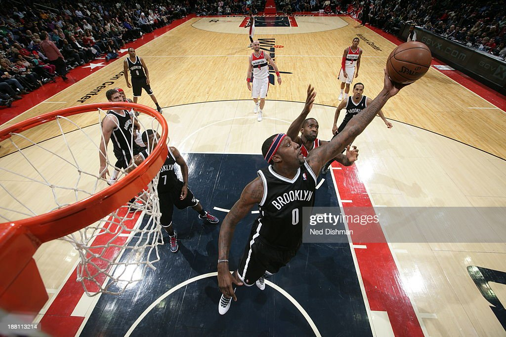 <a gi-track='captionPersonalityLinkClicked' href=/galleries/search?phrase=Andray+Blatche&family=editorial&specificpeople=4282797 ng-click='$event.stopPropagation()'>Andray Blatche</a> #0 of the Brooklyn Nets grabs the rebound against the Washington Wizards at the Verizon Center on November 8, 2013 in Washington, DC.