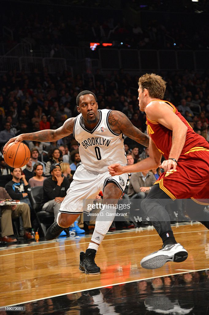 Andray Blatche #0 of the Brooklyn Nets handles the ball against Luke Walton #4 of the Cleveland Cavaliers at the Barclays Center on December 29, 2012 in Brooklyn, New York.