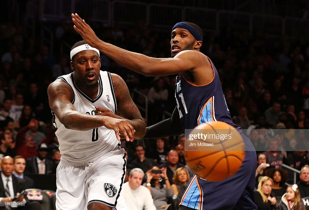 Andray Blatche #0 of the Brooklyn Nets in action against Hakim Warrick #21 of the Charlotte Bobcats at Barclays Center on December 28, 2012 in the Brooklyn borough of New York City.The Nets defeated the Bobcats 97-81.