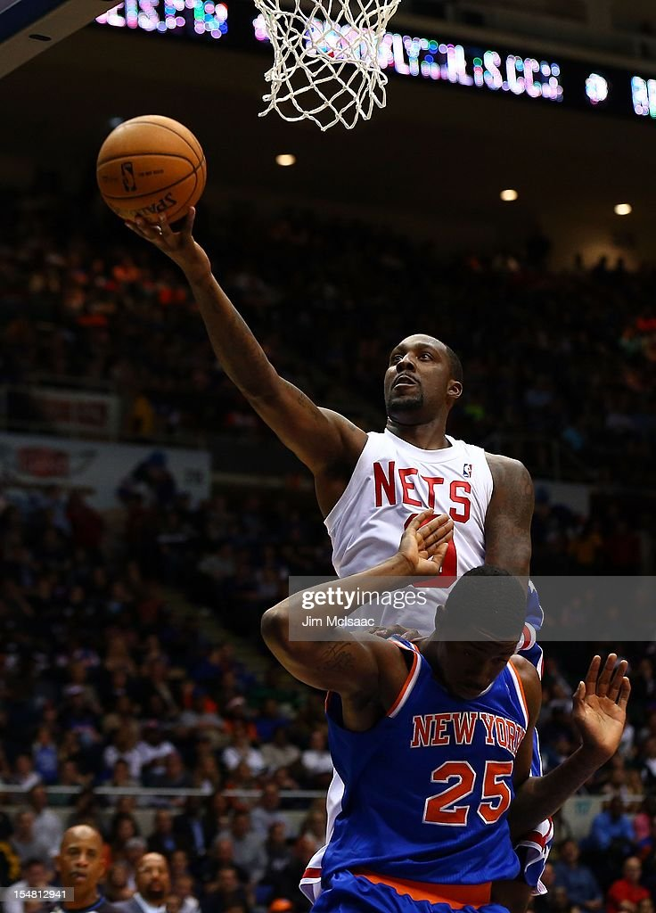Andray Blatche #0 of the Brooklyn Nets in action against Henry Sims #25 of the New York Knicks during a preseason game at Nassau Coliseum on October 24 2012 in Uniondale, New York The Knicks defeated the Nets 97-95.