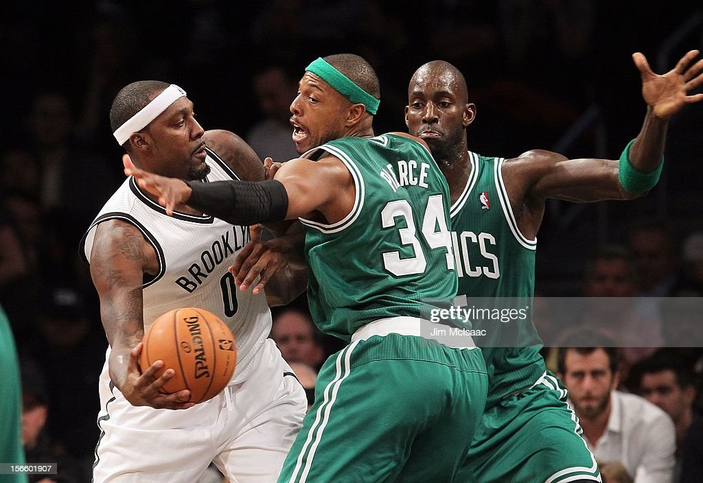 Andray Blatche #0 of the Brooklyn Nets in action against Paul Pierce #34 and Kevin Garnett #5 of the Boston Celtics at Barclays Center on November 15, 2012 in the Brooklyn borough of New York City.The Nets defeated the Celtics 102-97.