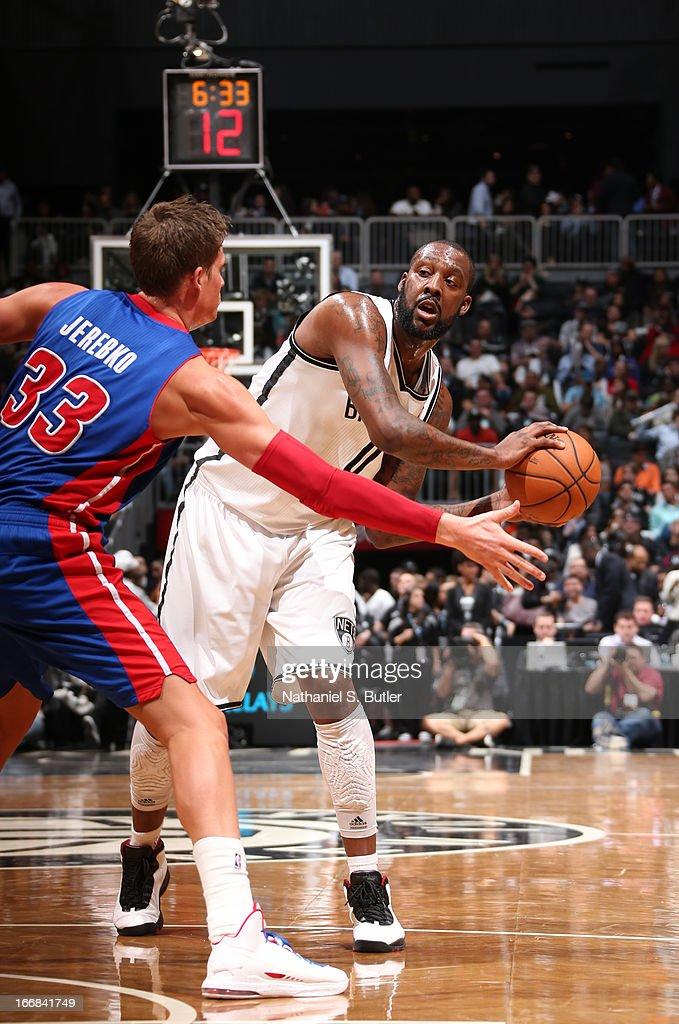 Andray Blatche #0 of the Brooklyn Nets looks for a pass against Jonas Jerebko #33 of the Detroit Pistons on April 17, 2013 at the Barclays Center in the Brooklyn borough of New York City.