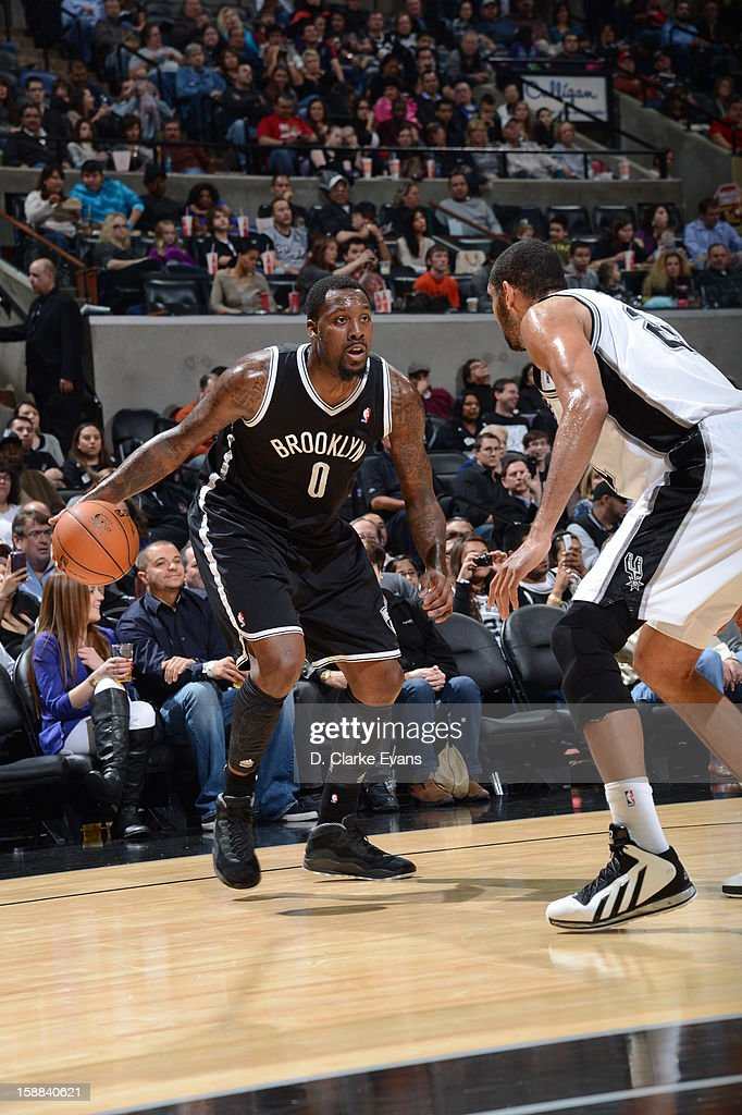 Andray Blatche #0 of the Brooklyn Nets looks to drive against Tim Duncan #21 of the San Antonio Spurs on December 31, 2012 at the AT&T Center in San Antonio, Texas.