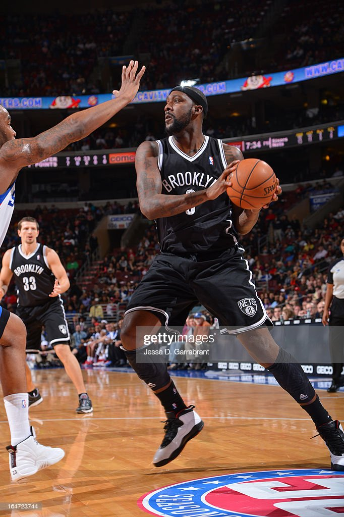 <a gi-track='captionPersonalityLinkClicked' href=/galleries/search?phrase=Andray+Blatche&family=editorial&specificpeople=4282797 ng-click='$event.stopPropagation()'>Andray Blatche</a> #0 of the Brooklyn Nets looks to shoot against the Philadelphia 76ers at the Wells Fargo Center on March 11, 2013 in Philadelphia, Pennsylvania.
