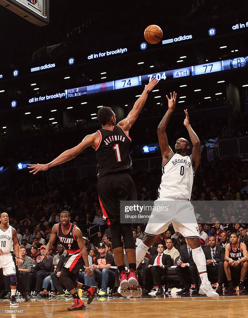 Andray Blatche #0 of the Brooklyn Nets misses a fourth quarter shot against the Portland Trail Blazers at the Barclays Center on November 25, 2012 in the Brooklyn borough of New York City.
