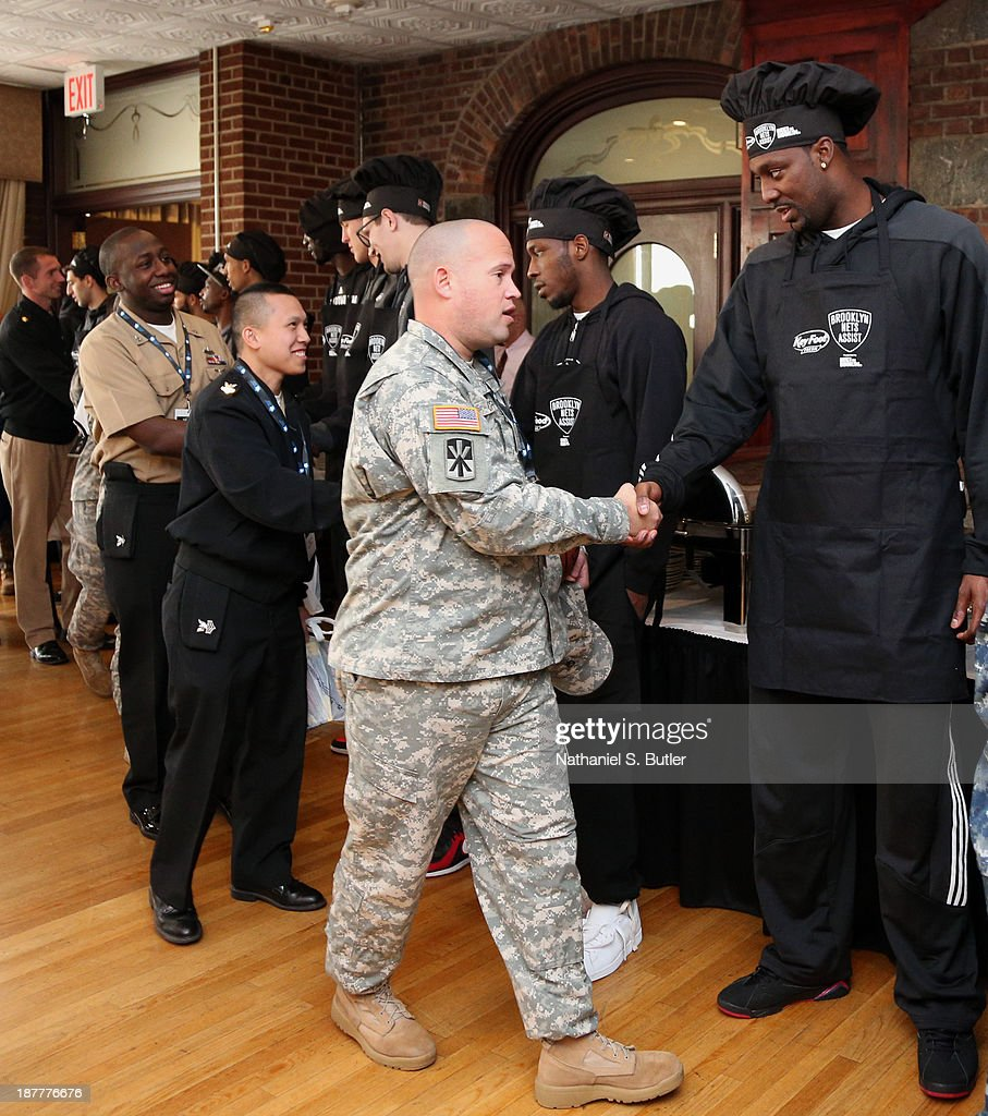 Andray Blatche #0 of the Brooklyn Nets poses for a picture during a team event in celebration of Veterans Day at Ft. Hamilton, Brooklyn on November 11, 2013 in the Brooklyn borough of New York City.