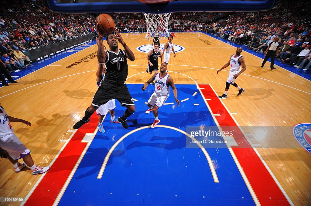 <a gi-track='captionPersonalityLinkClicked' href=/galleries/search?phrase=Andray+Blatche&family=editorial&specificpeople=4282797 ng-click='$event.stopPropagation()'>Andray Blatche</a> #0 of the Brooklyn Nets shoots against <a gi-track='captionPersonalityLinkClicked' href=/galleries/search?phrase=Arnett+Moultrie&family=editorial&specificpeople=5759676 ng-click='$event.stopPropagation()'>Arnett Moultrie</a> #5 of the Philadelphia 76ers during the game at the Wells Fargo Center on January 8, 2013 in Philadelphia, Pennsylvania.