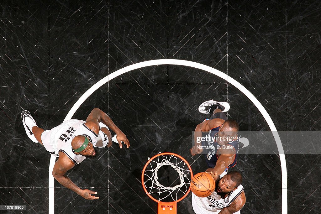 <a gi-track='captionPersonalityLinkClicked' href=/galleries/search?phrase=Andray+Blatche&family=editorial&specificpeople=4282797 ng-click='$event.stopPropagation()'>Andray Blatche</a> #0 of the Brooklyn Nets shoots against <a gi-track='captionPersonalityLinkClicked' href=/galleries/search?phrase=Bismack+Biyombo&family=editorial&specificpeople=7640443 ng-click='$event.stopPropagation()'>Bismack Biyombo</a> #0 of the Charlotte Bobcats on April 6, 2013 at the Barclays Center in the Brooklyn borough of New York City.
