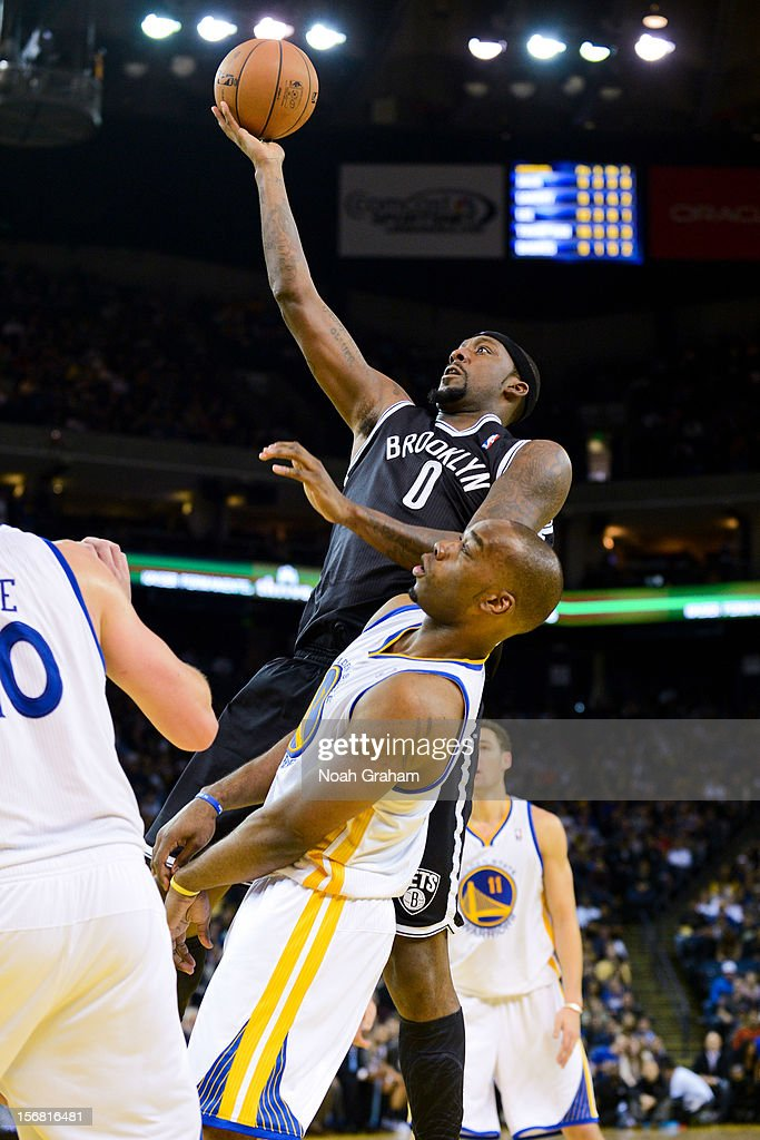 <a gi-track='captionPersonalityLinkClicked' href=/galleries/search?phrase=Andray+Blatche&family=editorial&specificpeople=4282797 ng-click='$event.stopPropagation()'>Andray Blatche</a> #0 of the Brooklyn Nets shoots against <a gi-track='captionPersonalityLinkClicked' href=/galleries/search?phrase=Carl+Landry&family=editorial&specificpeople=4111952 ng-click='$event.stopPropagation()'>Carl Landry</a> #7 of the Golden State Warriors at Oracle Arena on November 21, 2012 in Oakland, California.