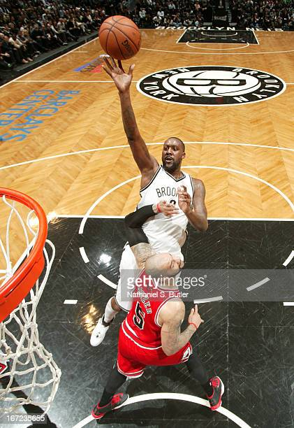 Andray Blatche of the Brooklyn Nets shoots against Carlos Boozer of the Chicago Bulls in Game Two of the Eastern Conference Quarterfinals during the...