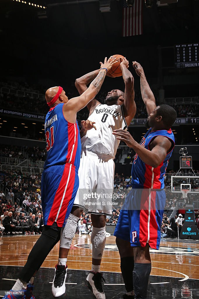 Andray Blatche #0 of the Brooklyn Nets shoots against Charlie Villanueva #31 and Will Bynum #12 of the Detroit Pistons on April 17, 2013 at the Barclays Center in the Brooklyn borough of New York City.