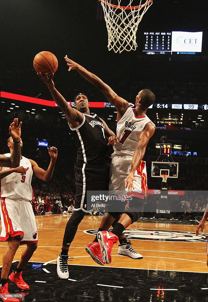 <a gi-track='captionPersonalityLinkClicked' href=/galleries/search?phrase=Andray+Blatche&family=editorial&specificpeople=4282797 ng-click='$event.stopPropagation()'>Andray Blatche</a> #0 of the Brooklyn Nets shoots against <a gi-track='captionPersonalityLinkClicked' href=/galleries/search?phrase=Chris+Bosh&family=editorial&specificpeople=201574 ng-click='$event.stopPropagation()'>Chris Bosh</a> #1 of the Miami Heat during their game at the Barclays Center on November 1, 2013 in the Brooklyn borough of New York City.