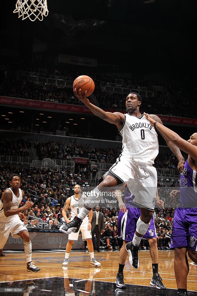 Andray Blatche #0 of the Brooklyn Nets shoots against Chuck Hayes #42 of the Sacramento Kings on January 5, 2013 at the Barclays Center in the Brooklyn borough of New York City.