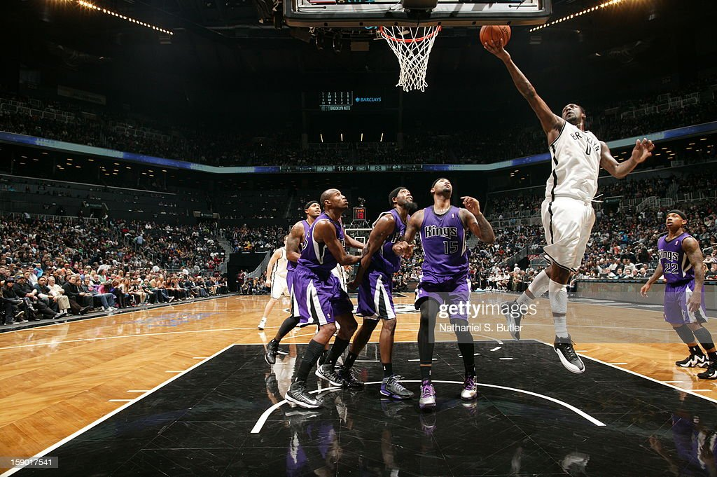 Andray Blatche #0 of the Brooklyn Nets shoots against DeMarcus Cousins #15 of the Sacramento Kings on January 5, 2013 at the Barclays Center in the Brooklyn borough of New York City.