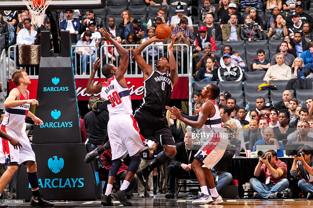 Andray Blatche #0 of the Brooklyn Nets shoots against Earl Barron #30 of the Washington Wizards during a pre-season game at the Barclays Center on October 15, 2012 in the Brooklyn borough of New York City.