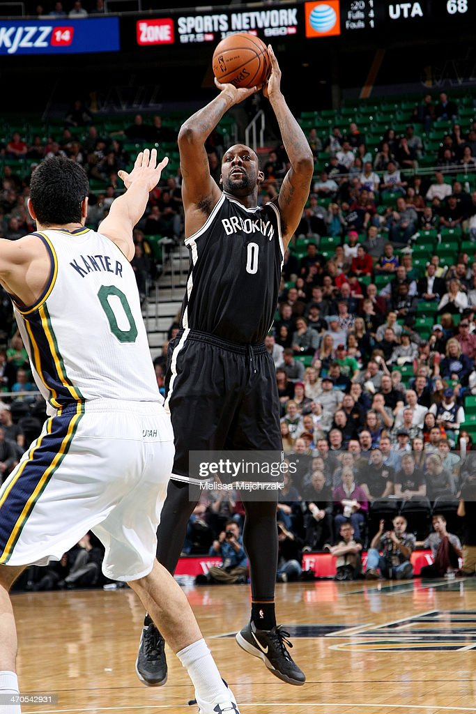 <a gi-track='captionPersonalityLinkClicked' href=/galleries/search?phrase=Andray+Blatche&family=editorial&specificpeople=4282797 ng-click='$event.stopPropagation()'>Andray Blatche</a> #0 of the Brooklyn Nets shoots against Enes Kanter #0 of the Utah Jazz at EnergySolutions Arena on February 19, 2014 in Salt Lake City, Utah.